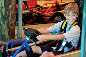 boy waiting to ride go kart