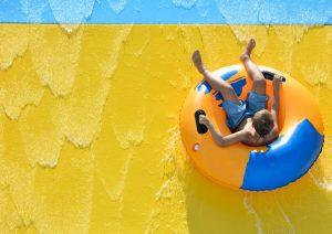 boy riding water slide