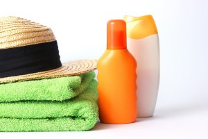 hat, towels, and sunscreen