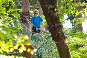 kid on a zipline tour canopy tree trek