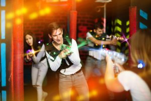 teenagers playing laser tag
